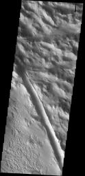 Dust slides are common in the dust covered region called Lycus Sulci. A  large fracture is also visible in this image