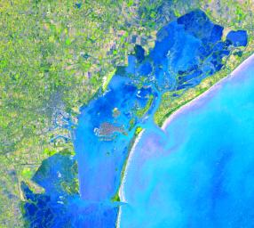 Four hundred bridges cross the labyrinth of canals that form the 120 islands of Venice, situated in a saltwater lagoon between the mouths of the Po and Piave rivers in northeast Italy. This image was acquired by NASA's Terra satellite on December 9, 2001.