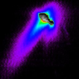 A composite of images from NASA's Deep Space 1 spacecraft shows features of comet Borrelly's nucleus, dust jets escaping the nucleus and the cloud-like 'coma' of dust and gases surrounding the nucleus.
