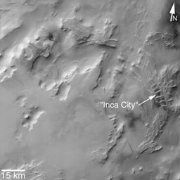 This image from NASA's Mars Global Surveyor (MGS) taken in 2002, shows that the 'Inca City' ridges, located at 82°S, 67°W, are part of a larger circular structure that is about 86 km (53 mi) across.