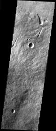 This image from NASA's Mars Odyssey shows the part of the NE flank of Arsia Mons where it meets the plains. The flank of the volcano is comprised of long flows. Collapse features are present at the flank margin.