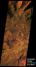 This image from NASA's Mars Odyssey spacecraft was acquired of Candor Chasma within Valles Marineris and shows the effects of erosion on a sequence of dramatically layered rocks.