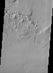 This THEMIS image shows parts of the dissected and eroded remnants of an impact crater rim and volcanic material located north of Apollinaris Patera near the southern highlands - northern lowlands dichotomy on Mars.