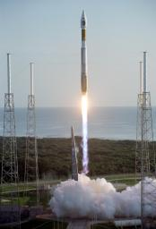 With the Atlantic Ocean as a backdrop, an Atlas V launch vehicle, 19 stories tall, with a two-ton NASA Mars Reconnaissance Orbiter (MRO) on top, roars away from Launch Complex 41 at Cape Canaveral Air Force Station.