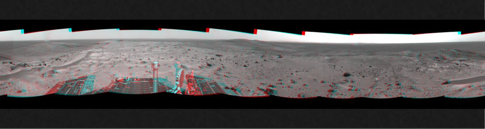 This anaglyph from NASA's Mars Exploration Rover, Spiriti, was taken from the summit of 'Husband Hill,' three dust devils are clearly visible in the plains of Gusev Crater. 3D glasses are necessary to view this image.