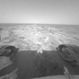 NASA's Spirit rover took this image showing Mars' soil is marked by wind-blown ripples and dust deposits, indicating that the summit is a very windy place. The soil composition is similar to that of deposits found in the plains.