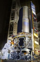 Technicians put final touches on NASA's Space Infrared Telescope Facility at Lockheed Martin Aeronautics in Sunnyvale, Calif., which launched on August 25, 2003. The telescope is now known as the Spitzer Space Telescope.