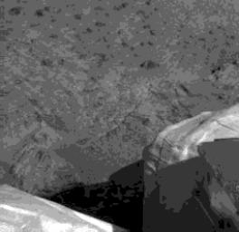 This is the first image captured by NASA's Imager for Mars Pathfinder (IMP) that dedicates a significant portion of the frame to the Martian surface. This image was acquired by IMP at 8:48 MLST sol 1.