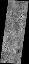 The small mounds with summit depressions in the northern part of this NASA Mars Odyssey image have an unknown origin. Some scientists think they may be cinder cones, while others think they may be pseudocraters, formed by the interaction of lava and ice.