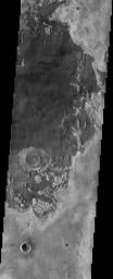The remarkable terrain at the 'center' of Mars (0 degrees latitude and longitude), as seen in this NASA Mars Odyssey image, is called Meridiani Planum. It hosts a rare occurrence of gray crystalline hematite.