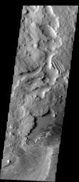 This image from NASA's Mars Odyssey shows the westernmost extent of the Medusae Fossae Formation on Mars, a 5000+ km long belt of eroding sediments, the interleaving of erosional surfaces produces dramatic textural variations.