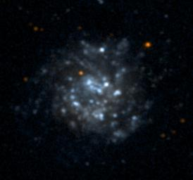 NASA's Galaxy Evolution Explorer took this ultraviolet color image of the galaxy NGC5474 on June 7, 2003. NGC5474 is located 20 million light-years from Earth and is within a group of galaxies dominated by the Messier 101 galaxy.