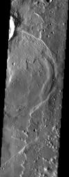 NASA's Mars Odyssey spacecraft captured this image in July 2003, showing a complex process of deposition, burial and exhumation. The crater ejecta at top is in the form of flow lobes, indicating that the crater was formed in volatile-rich terrain.
