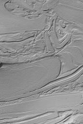 This image from NASA's Mars Global Surveyor shows strangest-looking surfaces on Mars occur in northwestern Hellas Planitia informally known as 'taffy-pull' terrain.