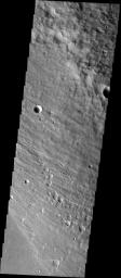 he western-most mound of the discontinuous deposit of Medusae Fossae Formation (MFF) shows a style of erosion different from the typical in this image captured by NASA's Mars Odyssey spacecraft in October 2003.