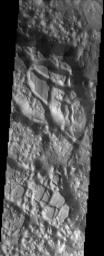 Aureum Chaos is a large crater that was filled with sediment after its formation. This image was captured by NASA's Mars Odyssey spacecraft in November 2003.