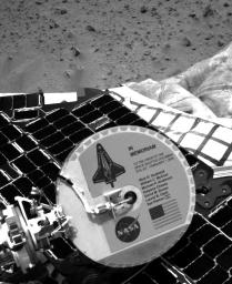 A plaque commemorating the astronauts who died in the tragic accident of the Space Shuttle Columbia is mounted on the back of NASA's Mars Exploration Rover Spirit's high-gain antenna.