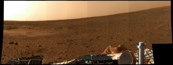 This color postcard from Mars, taken on Sol 5 by the panoramic camera onboard NASA's Mars Exploration Rover Spirit, looks to the north. The apparent slope of the horizon is due to the several-degree tilt of the lander deck.