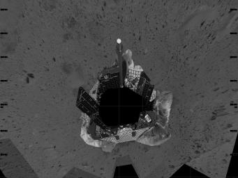 This mosaic image taken by the navigation camera on NASA's Mars Exploration Rover Spirit represents an overhead view of the rover as it prepares to roll off the lander and onto the martian surface.