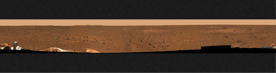 This is a medium-resolution version of the first 360-degree panoramic view of the martian surface, taken on Mars by NASA's Mars Exploration Rover Spirit's panoramic camera. Part of the spacecraft can be seen in the lower corner regions.