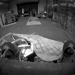 This image shows a test rover in a near-final turned position on the lander in NASA's Jet Propulsion Laboratory's In-Situ Instruments Laboratory, or 'testbed.'