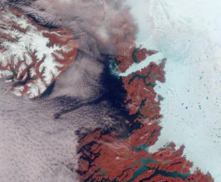 Vibrant reds, emerald greens, brilliant whites, and pastel blues adorn this view of the area surrounding the Jakobshavn Glacier on the western coast of Greenland captured by NASA's Terra spacecraft on June 18, 2003.
