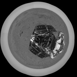 This overhead polar image was captured after NASA's Mars Exploration Rover Spirit took a few baby rolls away from the spacecraft that bore it millions of miles to Mars in 2004. The empty lander is seen to the right of the rover.