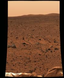 This image taken by the panoramic camera onboard NASA's Mars Exploration Rover Spirit before it rolled off the lander shows the rocky surface of Mars. The lander's deflated airbags can be seen in the foreground.