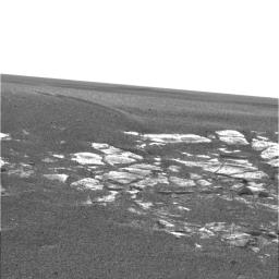 NASA's Mars Exploration Rover Opportunity shows the view of the martian landscape southwest of the rover. The image was taken in the late martian afternoon at Meridiani Planum on Mars