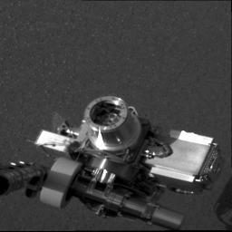 NASA's Mars Exploration Rover Opportunity shows the rover's alpha particle X-ray spectrometer (circular device in center), located on its instrument deployment device, or 'arm.'