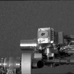 NASA's Mars Exploration Rover Opportunity shows the rover's Moessbauer spectrometer (circular device in center), located on its instrument deployment device, or 'arm.'
