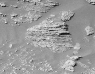 Layered rocks are seen by NASA's Opportunity rover on Feb. 9, 2004 in Opportunity Ledge. Unparallel lines give unparalleled clues that some 'moving current' such as volcanic flow, wind, or water formed these rocks.