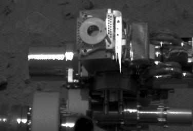 This close-up image of NASA's Mars Exploration Rover Spirit's instrument deployment device, or 'arm,' shows the donut-shaped plate on the Moessbauer spectrometer.