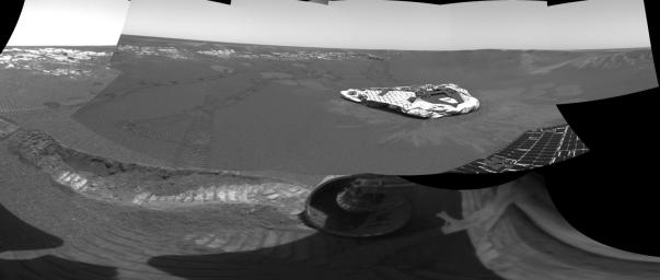 NASA's Mars Exploration Rover Opportunity dragged one of its wheels back and forth across the sandy soil at Meridiani Planum to create a hole.