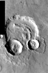This image, part of an images as art series from NASA's 2001 Mars Odyssey released on Feb 18, 2004 shows a cratered martian suface strongly resembling a pair of headphones.