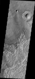 This image from NASA's 2001 Mars Odyssey released on March 17, 2004 shows a crater on Mars at the upper right was once buried, and is now being exhumed.