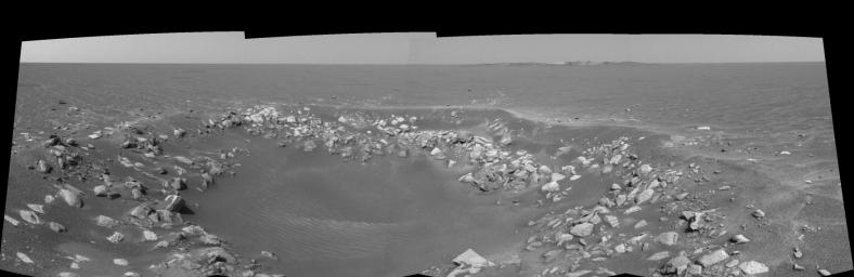 This cylindrical projection was taken by the navigation camera onboard NASA's Mars Exploration Rover Opportunity. The view is a region dubbed 'Fram Crater' located .3 miles from 'Eagle Crater' and roughly 820 feet from 'Endurance Crater' (upper right).