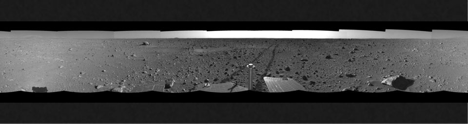 This left-eye view was created from navigation camera images that NASA's Mars Exploration Rover Spirit acquired on May 12, 2004. The tracks show the path the rover had traveled so far on its way to the base of the 'Columbia Hills.'