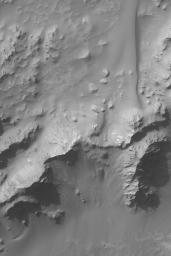 NASA's Mars Global Surveyor shows some of the mountains that make up the central peak region of Hale Crater on Mars. The central peak of a crater consists of rock brought up during the impact from below the crater floor.