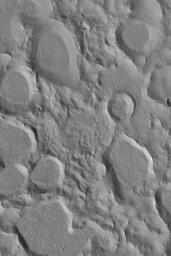 NASA's Mars Global Surveyor shows a portion of a large field of small craters clustered together in northeastern Arabia Terra on Mars. Crater clusters usually result from the secondary impact of debris thrown from a much larger impact.