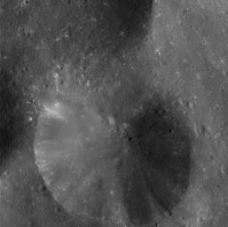 This eye-popping high-resolution image captured by NASA's Cassini spacecraft shows Phoebe's pitted surface.