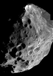 During its historic close encounter with Phoebe, NASA's Cassini spacecraft captured a series of high resolution images of the small moon, six of which have been put together to create this mosaic.