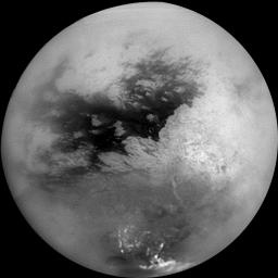 A mosaic of nine processed images recently acquired during NASA's Cassini spacecraft first very close flyby of Saturn's moon Titan on Oct. 26, 2004, constitutes the most detailed full-disc view of the mysterious moon.