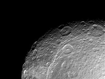 This incredible, high resolution view of Saturn's moon Dione was taken during NASA's Cassini spacecraft first close approach to the icy moon on Dec. 14, 2004.
