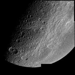 This very detailed image captured by NASA's Cassini spacecraft closest approach to Saturn's moon Dione on Dec. 14, 2004 is centered on the wispy terrain of the moon.