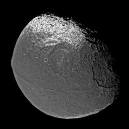 On New Year's Eve 2004, NASA's Cassini spacecraft flew past Saturn's intriguing moon Iapetus, capturing the four visible light images that were put together to form this global view.