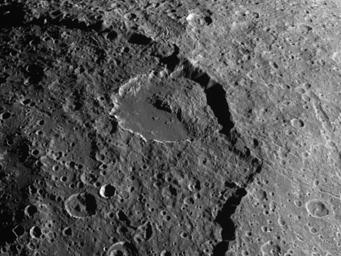 A spectacular landslide within the low-brightness region of Iapetus's surface known as Cassini Regio is visible in this image captured by NASA's Cassini spacecraft.