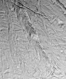 This high-resolution image from NASA's Cassini spacecraft shows a region of 'smooth plains' terrain on the surface of Saturn's moon Enceladus, located slightly north of the equator on the moon's Saturn-facing hemisphere.