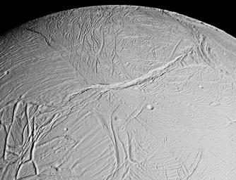 This spectacular view is a mosaic of four high resolution images taken by the NASA's Cassini spacecraft narrow angle camera on Feb. 16, 2005, during its close flyby of Saturn's moon Enceladus.