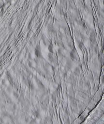 The finest details on the surface of Saturn's moon Enceladus are revealed in this 30-meter per-pixel, enhanced-color image taken during NASA's Cassini spacecraft closest-ever encounter with Enceladus on March 9, 2005.